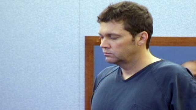 A shackled Benjamin Frazier closes his eyes during his first hearing in Las Vegas on Oct. 30, 2013. (FOX5/Peter Dawson)