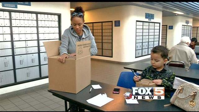 Jasmine Barr prepares packages for shipment at the post office on Sunset Road in Las Vegas. (FOX5)