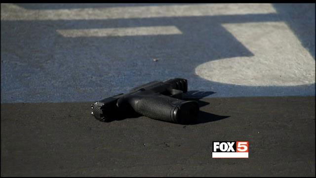 A handgun was found at the scene of a shooting outside a hookah lounge on Spring Mountain Road on Dec. 15, 2013. (FOX5)