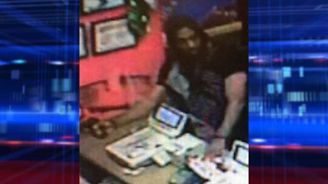 Police said the suspect reached over the cash register and grabbed money from the drawer. (LVMPD)