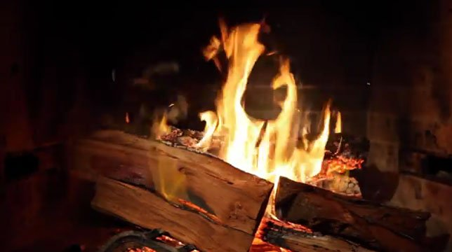 """A trailer for """"Fireplace For Your Home"""" intercuts not-so-serious reviews of the streaming video piece. (Source: YouTube/Netflix)"""