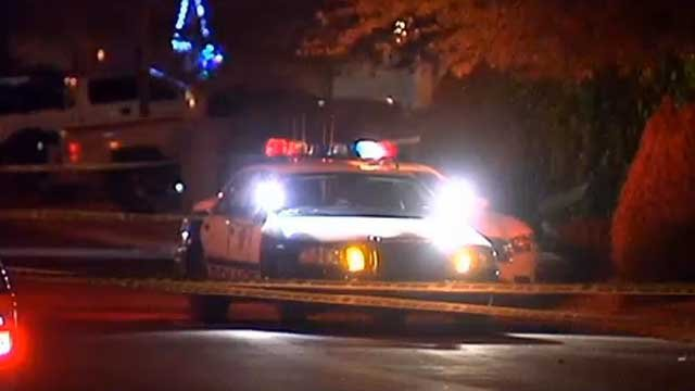 Police cruisers and crime scene tape surround the scene of a fatal shooting on Evening Rain Avenue on Dec. 22, 2013. (FOX5)