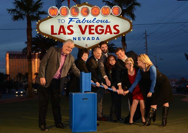 """Las Vegas leaders and environmental group leaders ceremoniously flip the switch on a solar power project at the """"Welcome to Fabulous Las Vegas"""" sign on Wednesday, Jan. 8. (Courtesy: Las Vegas News Bureau/Darrin Bush)"""