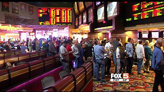 Sports bettors formed long lined at the Las Vegas Hotel sports book on Jan. 20, 2014. (FOX5)