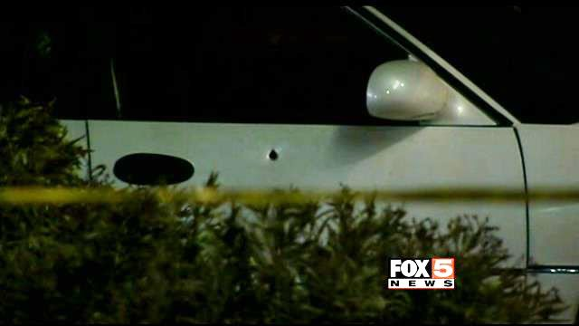 A bullet hole was left on a passenger side door after three-vehicle crash on Jan. 21, 2014. (FOX5)