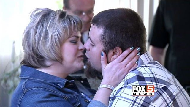 Crystal and Bobby Dezarov kiss each other after being pronounced married at the Chapel of Bells on Jan. 21, 2014. (FOX5)