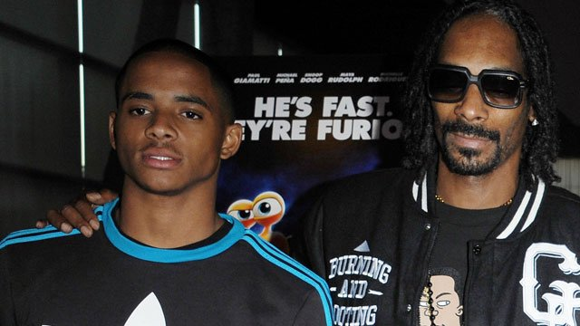 """Cordell Broadus (left) and Snoop Dogg attend the Snoop Dogg and The Snoop Youth Football League's special screening of """"Turbo"""" at the ArcLight Hollywood on Tuesday, July 16, 2013 in Los Angeles. (Photo by Katy Winn/Invision/AP)"""