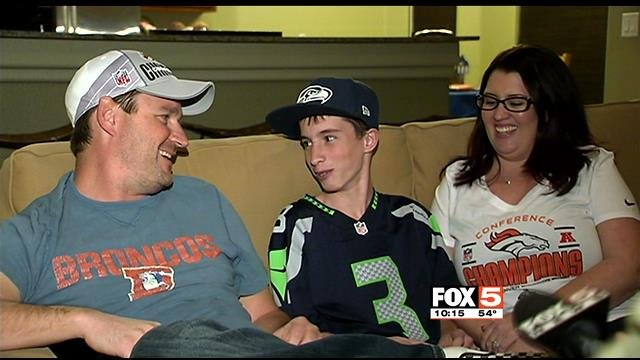 Sean (left) and Lindsay Ainsworth (right), the Broncos fans in the household, have a bet with their son, Christian (middle), who is rooting for the Seahawks. (FOX5)