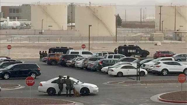 In this viewer-submitted picture, SWAT officers and police vehicles are seen milling about the scene of a standoff near Nellis Air Force Base on Jan. 30, 2014. (FOX5 Report It)