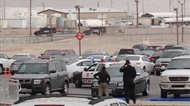 In this viewer-submitted picture, officers look on during a standoff near Nellis Air Force Base on Jan. 30, 2013. (FOX5 Report It)