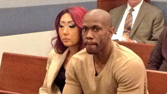 Gloria Lee, left, sat inside a court room on Feb. 5, 2014 with a man identified as her estranged husband. (FOX5)
