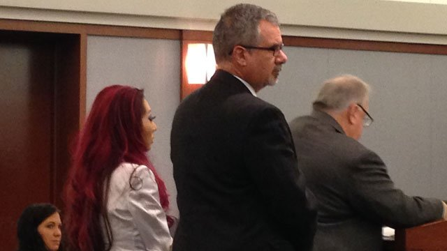 Gloria Lee, left, stands in court during a motion hearing on Feb. 7, 2014. (Danielle Miller/FOX5)