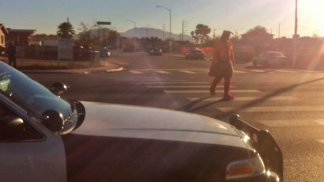 Officers clad in turkey costumes plan to cross busy streets as part of a holiday enforcement on Nov. 26, 2013. (Shannon Moore/FOX5)