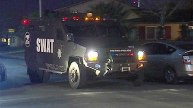 A SWAT vehicle weaves through parked cars on Skytrail Avenue during a standoff Feb. 16, 2014. (FOX5)
