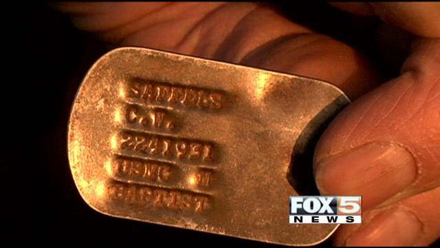 Former Marine Charles Saffles displays the dog tag he hadn't seen since serving in Vietnam in the 1960s. (FOX5)
