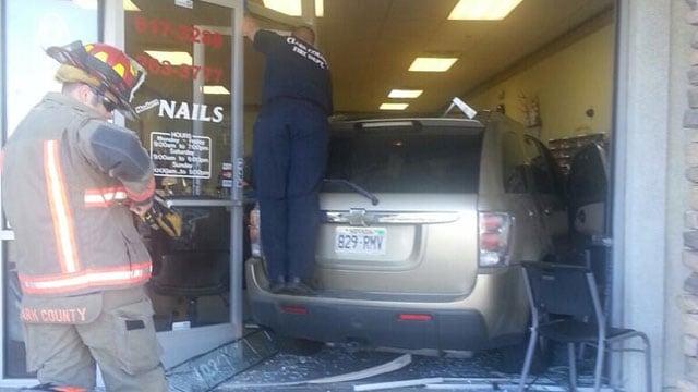 Police said a woman was behind the wheel of a vehicle that slammed into a nail salon on Jones Boulevard on Feb. 21, 2014. (Jason Westerhaus/FOX5)