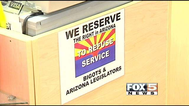 A sign at Totally Awesome Printing in Bullhead City, AZ, hangs in protest of SB 1062. (FOX5)