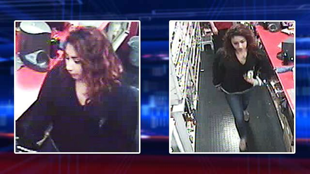 Police said a woman held a worker at gunpoint in a holdup that took place on Feb. 6, 2014. (LVMPD)
