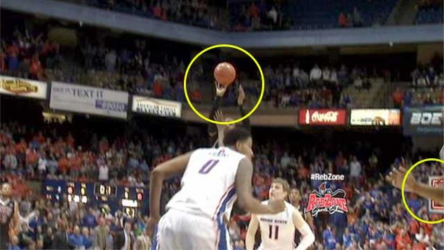 This image taken from video of Deville Smith's buzzer-beating shot against Boise St. on Feb. 22, 2014, highlights the position of the ball and the red-lit goal at the opposite end of the court. (FOX5)