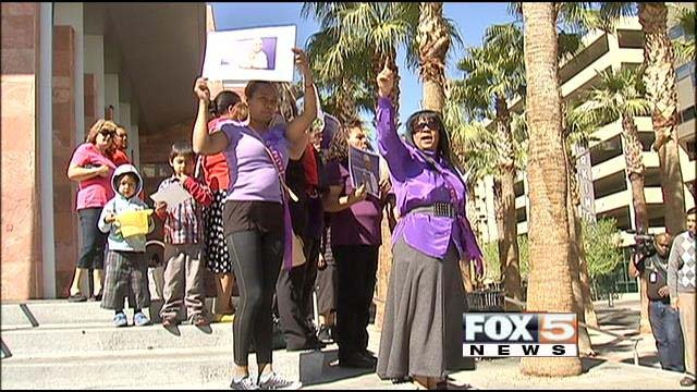 Domestic violence survivors rally outside of the Regional Justice Center in downtown Las Vegas on Monday, Feb. 24. (FOX5)