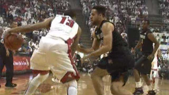 UNLV's Bryce Dejean-Jones tries to get by a San Diego St. defender March 5, 2014. (FOX5)