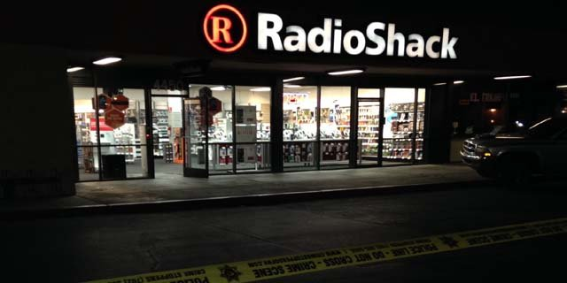 Crime tape is visible in front of a Radio Shack store on Charleston Boulevard in Las Vegas following a robbery on Thursday, March 6. (Joe Lybarger/FOX5)
