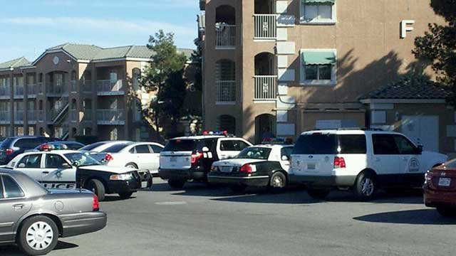 Several police vehicles are parked outside a Budget Suites after a body was found March 11, 2014. (Roger Bryner/FOX5)