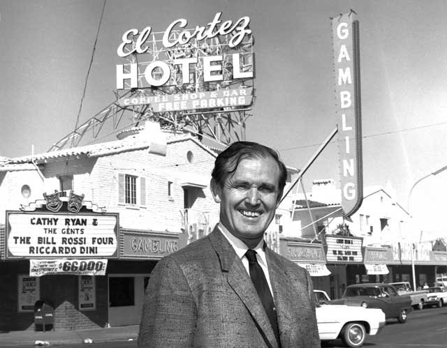 In this file photo provided by the Las Vegas News Bureau, casino owner Jackie Gaughan poses in front of his El Cortez Hotel and Casino in downtown Las Vegas on April 22, 1965. (AP Photo/Las Vegas News Bureau)