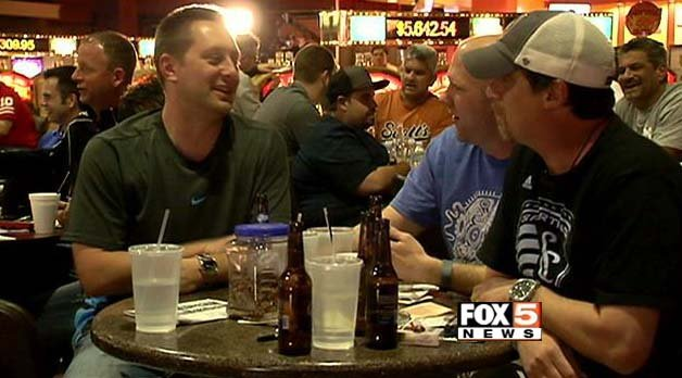 College basketball fans take in NCAA Tournament action at the LVH Superbook. (FOX5)