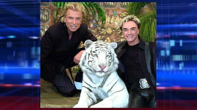 Siegfried Fischbacher, left, and Roy Horn appear with white tiger Mantecore in this undated image. (Source: Facebook)