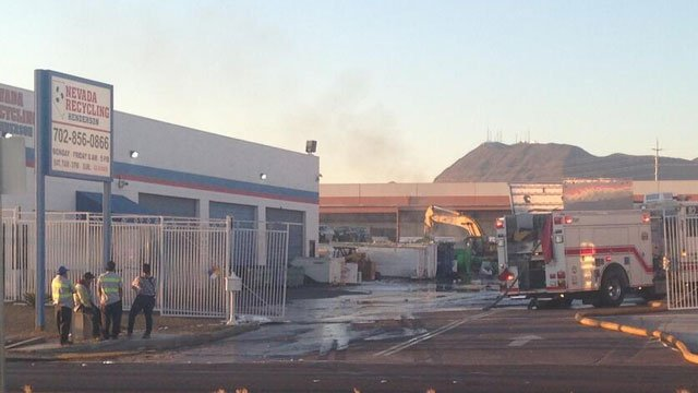 Smoke smolders at Nevada Recycling after a reported small explosion and fire on April 8, 2014. (Peter Dawson/FOX5)