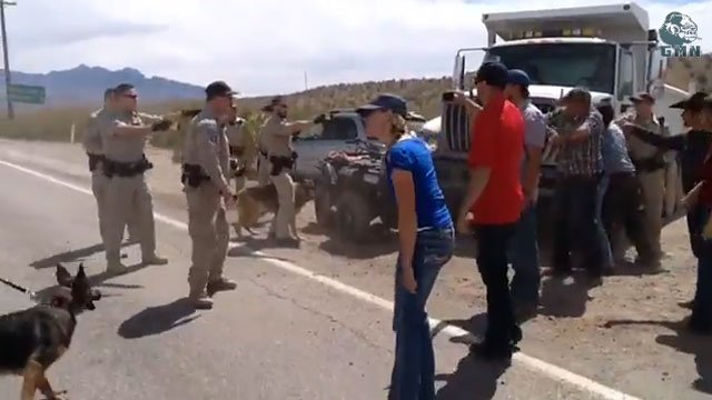 A screen capture of video posted on YouTube on April 9, 2014 shows stun guns drawn on protesters in dispute with Bureau of Land Management agents. (Source: YouTube/GMN Telemedia)