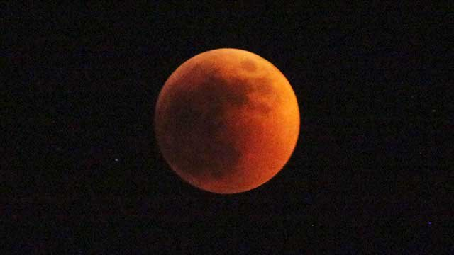 The moon turns red during a total lunar eclipse seen in Nairobio, Kenya, June 15, 2011. (AP Photo/Sayyid Azim)