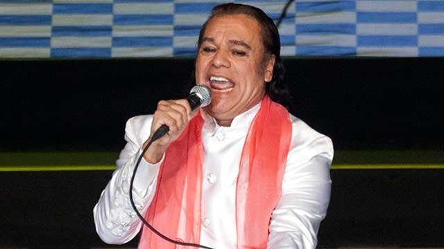 Mexican singer Juan Gabriel performs in concert at the National Auditorium in Mexico City, late Tuesday Feb. 14, 2012. (AP Photo/Eduardo Verdugo)