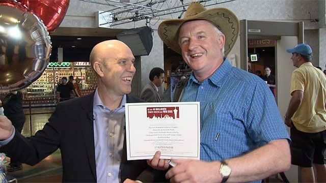 Paul Hobson (left) and James Kennedy smile for the cameras after Kennedy is recognized as the 40 millionth visitor to the Stratosphere on April 21, 2014. (Joe Lybarger/FOX5)