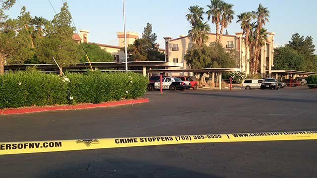 Crime scene tape and police cruisers are seen in the parking lot of Sportsman's Royal Manor on May 6, 2014. (Peter Dawson/FOX5)