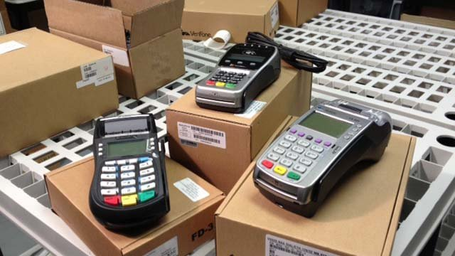 EMV-enabled machines on display at Global 1 Wholesale Merchant Services. (Elizabeth Watts/FOX5)