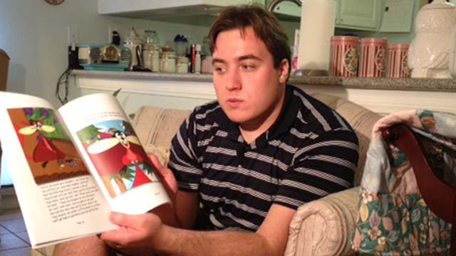Ben Nelson with a copy of his first illustrated book, Little Red Flying Hood. (Elizabeth Watts/FOX5)