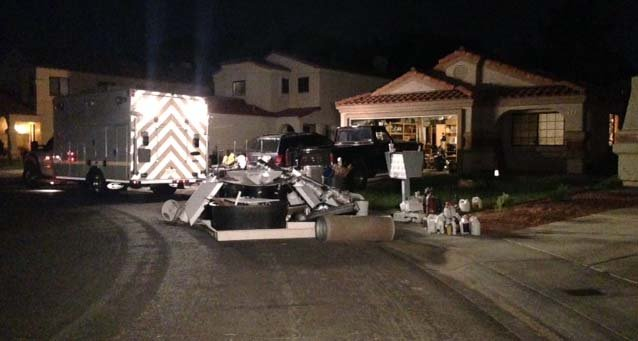 Chemicals and other items in front of a home on Pinnacle Court in Henderson suspected of housing a marijuana grow operation. (Erik Ho/FOX5)