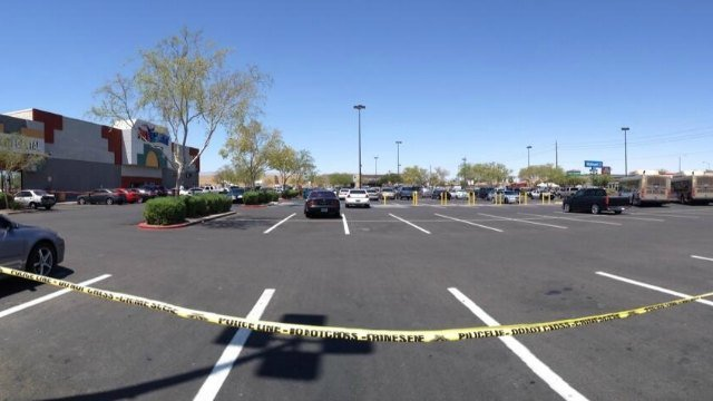 Police tape blocked off a section of a shopping center where two people suspected of shooting two Metro officers died on June 8, 2014. (Rachel Moore/FOX5)