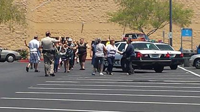 Las Vegas Metro police officers led people out of a Walmart near Nellis Boulevard and Stewart Avenue after two gunmen entered in the store. (FOX5 ReportIt user)