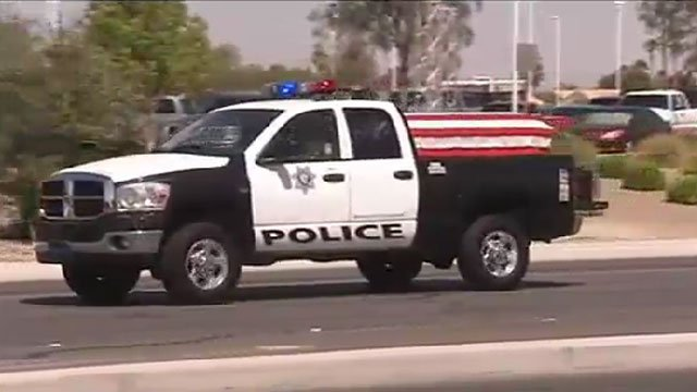 A Las Vegas Metro police vehicle carrying the casket of fallen Officer Igor Soldo proceeds toward Canyon Ridge Church on June 12, 2014. (FOX5)