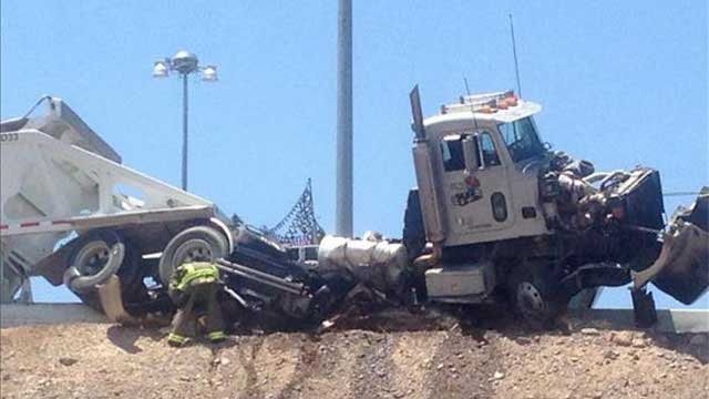 The mangled remains of a semi a perched on a ledge along U.S. Highway 95 after a fatal crash June 12, 2014. (FOX5 Report It)