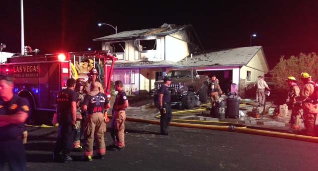 Las Vegas Fire and Rescue crews outside a house on Huntley Road that burned on Thursday, June 12. (Erik Ho/FOX5)