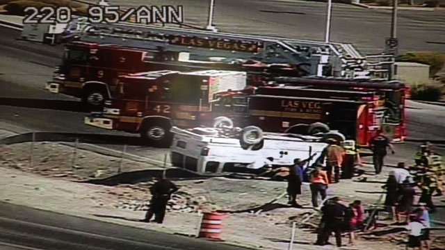 Las Vegas Fire and Rescue crews rushed to a rolled over white van near U.S. 95 and Ann Road on June 13, 2014. (LV ACTS)