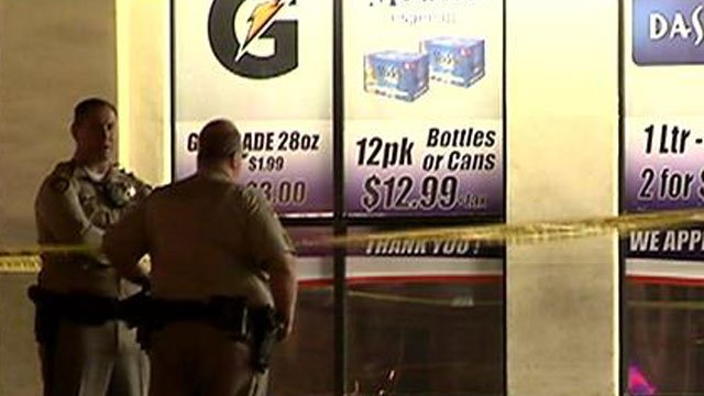 Police investigate a shooting that took place at a gas station on West Tropicana Avenue on June 17, 2014. (LVMPD)