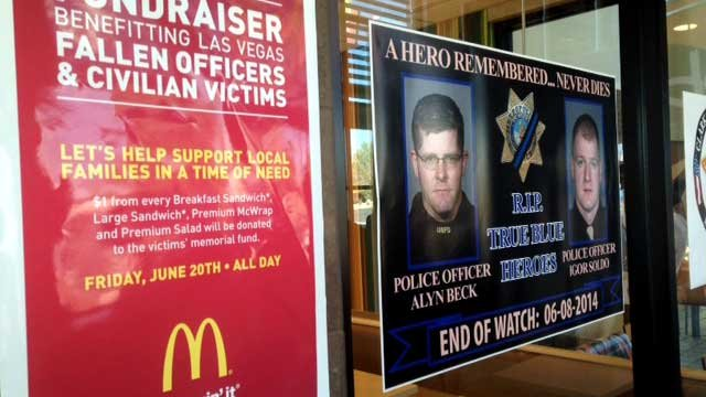 A banner notifying customers of Friday's fundraiser hands in the window of a McDonald's location June 19, 2014. (FOX5)