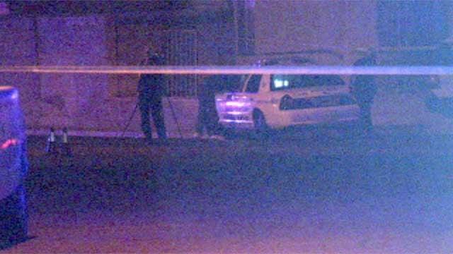 Investigators mill about the scene of a fatal shooting in North Las Vegas on July 3, 2014. (Armando Navarro/FOX5)