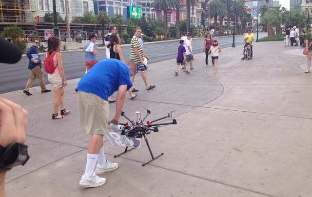 A pilot for DroneCast operates a drone on the Las Vegas Strip during a demonstration on Thursday, July 10. (Les Krifaton/FOX5)
