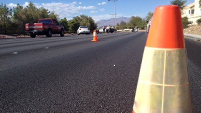 Las Vegas Metro police closed off Rampart Boulevard near Point Conception Drive after a deadly motorcycle crash on July 13, 2014. (Rachel Moore/FOX5)